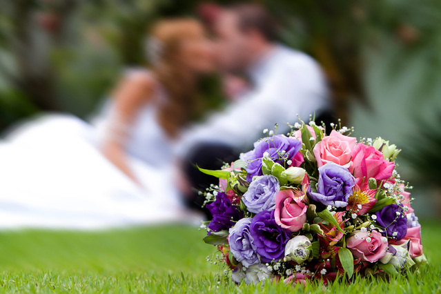 beautiful-bouquet-with-groom-and-bride-at-back-1374339-639x425.jpg
