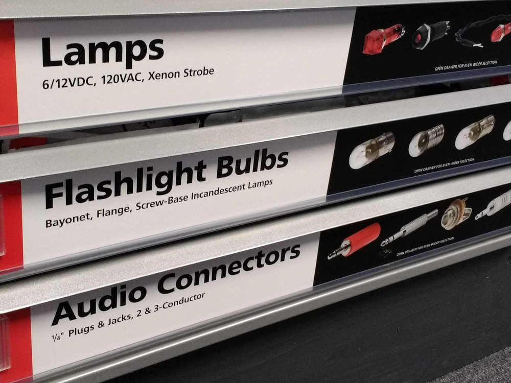 Drawers of lamps, flashlight bulbs and audio connectors.