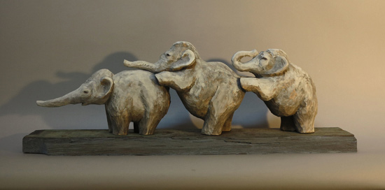 "Elephant Trio, 2013 carved and painted basswood 25"" x 9"" x 5"""