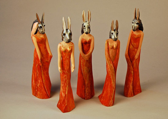 "Bridesmaids, 2009 carved and painted wood with garnet eyes 11""x 18"" x 3"""