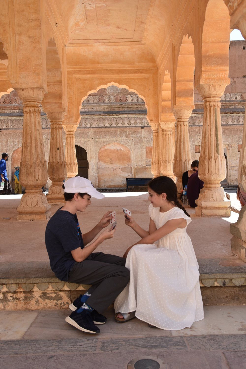 Q and Amelia play cards everywhere - here they are at the Amer Fort