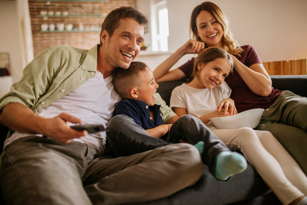 Playful-young-family-watching-television-520653076_2125x1416.jpeg