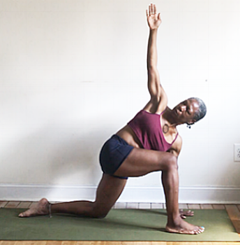 parivrtta anjaneyasana. (rotated crescent moon pose variation)