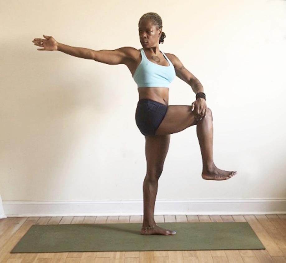 parivrtta hasta padangusthasana. (standing rotated hand to foot pose) variation holding knee