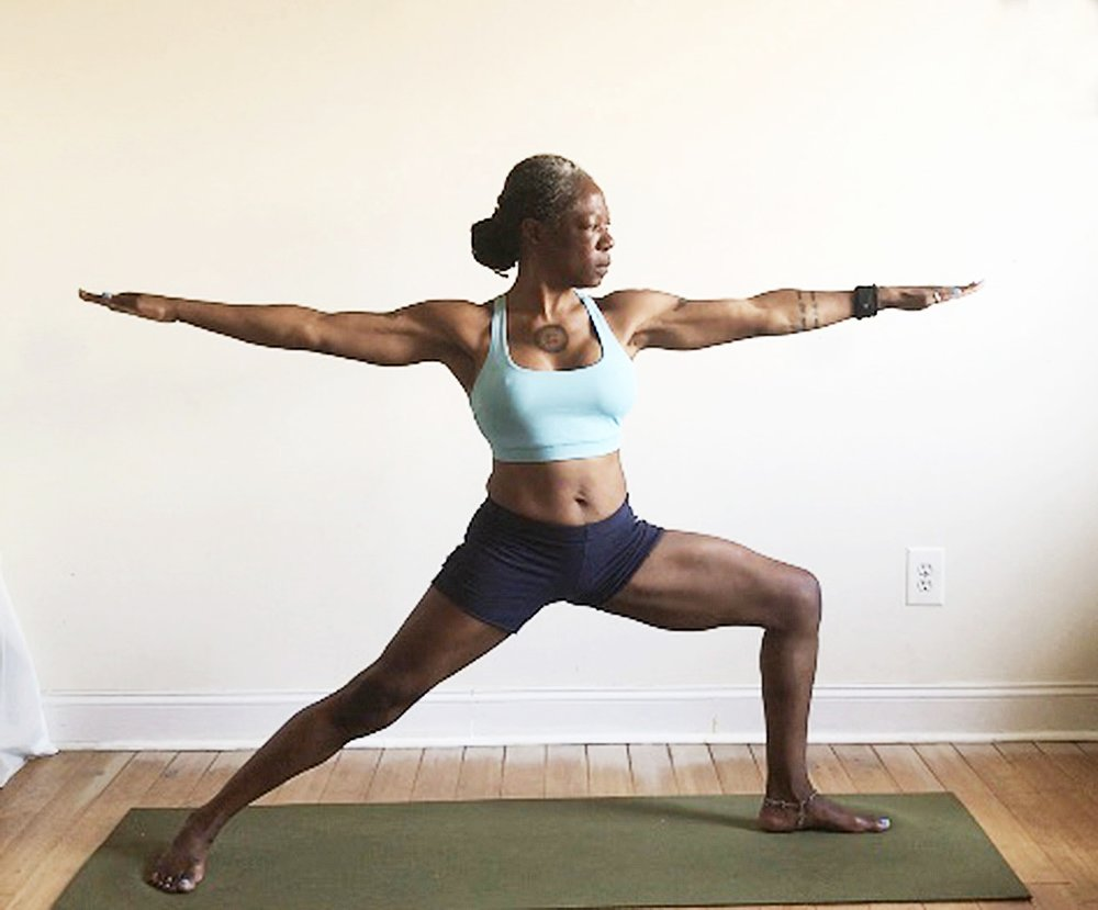 virabhadrasana II. (warrior two pose): shoulders over hips. back toes turned out.