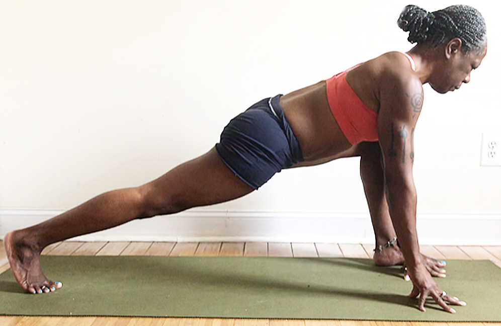 ashwa sanchalanasana. (low lunge wide variation pose): with hands inside the front foot