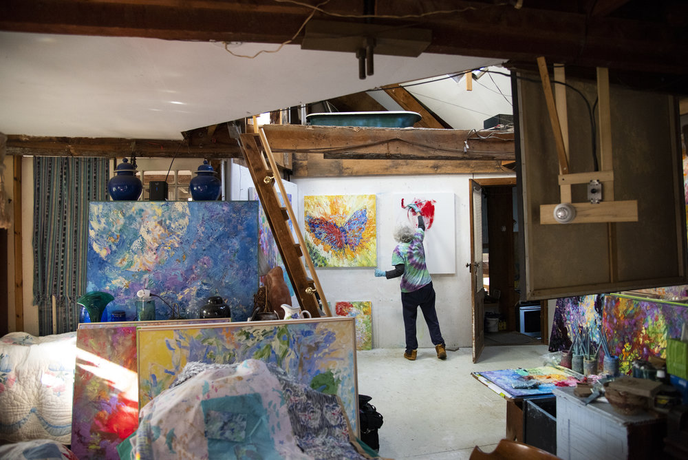 Jean Forsberg, a retired Penn State instructor, works on a painting in her Julian Woods home. Julian Woods is a small woodland community located in central Pennsylvania that has about 20 residents who live on shared land.