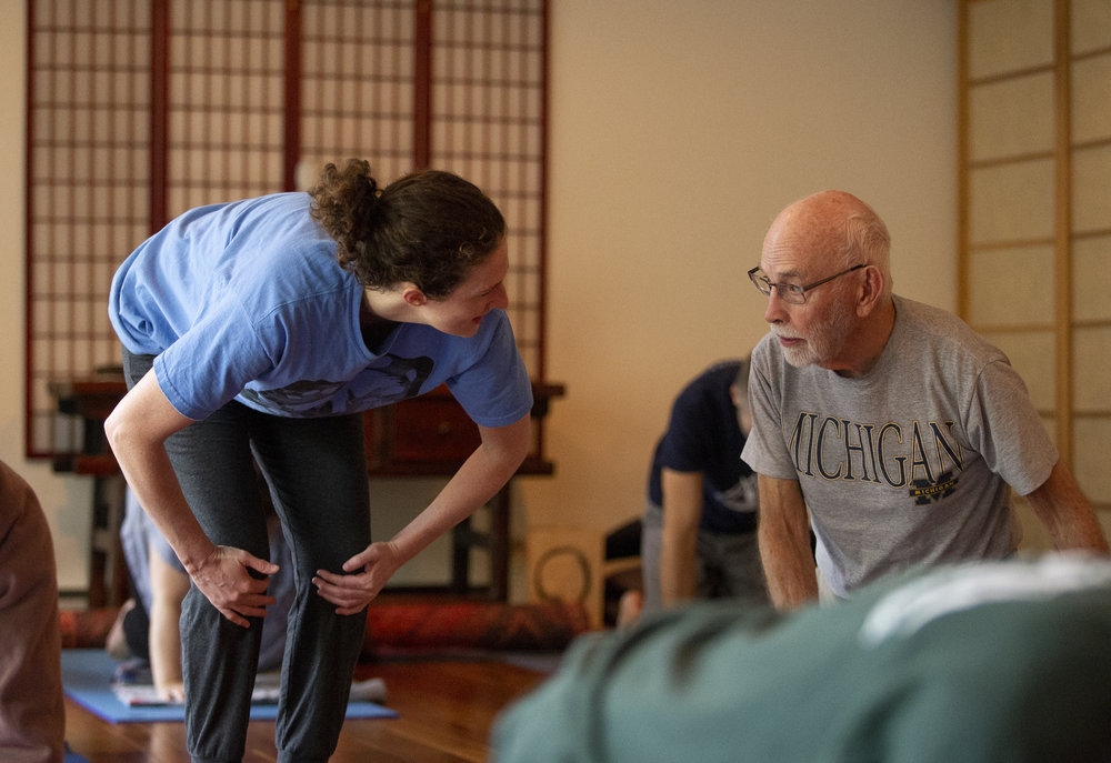 Amy Fisher, left, helps participants in her Saturday morning yoga class at O-An Zendo. Amy Fisher, Deb Fisher's daughter, grew up in Julian Woods with her mom and sister.