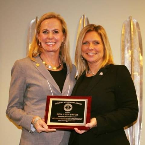 Lynn receives the coveted Carroll M. Redford Award in February 2018 from Courtney Baxter, President of Commonwealth's Attorney's Association.