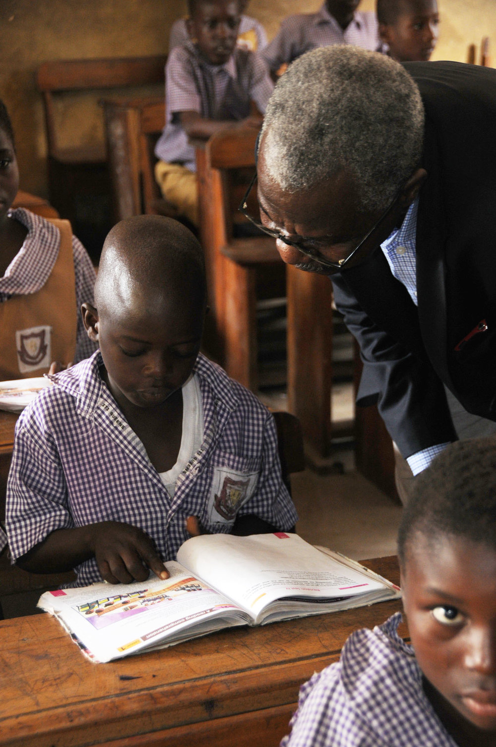 Student explaining his recent readings to Mr. Fagbayi.