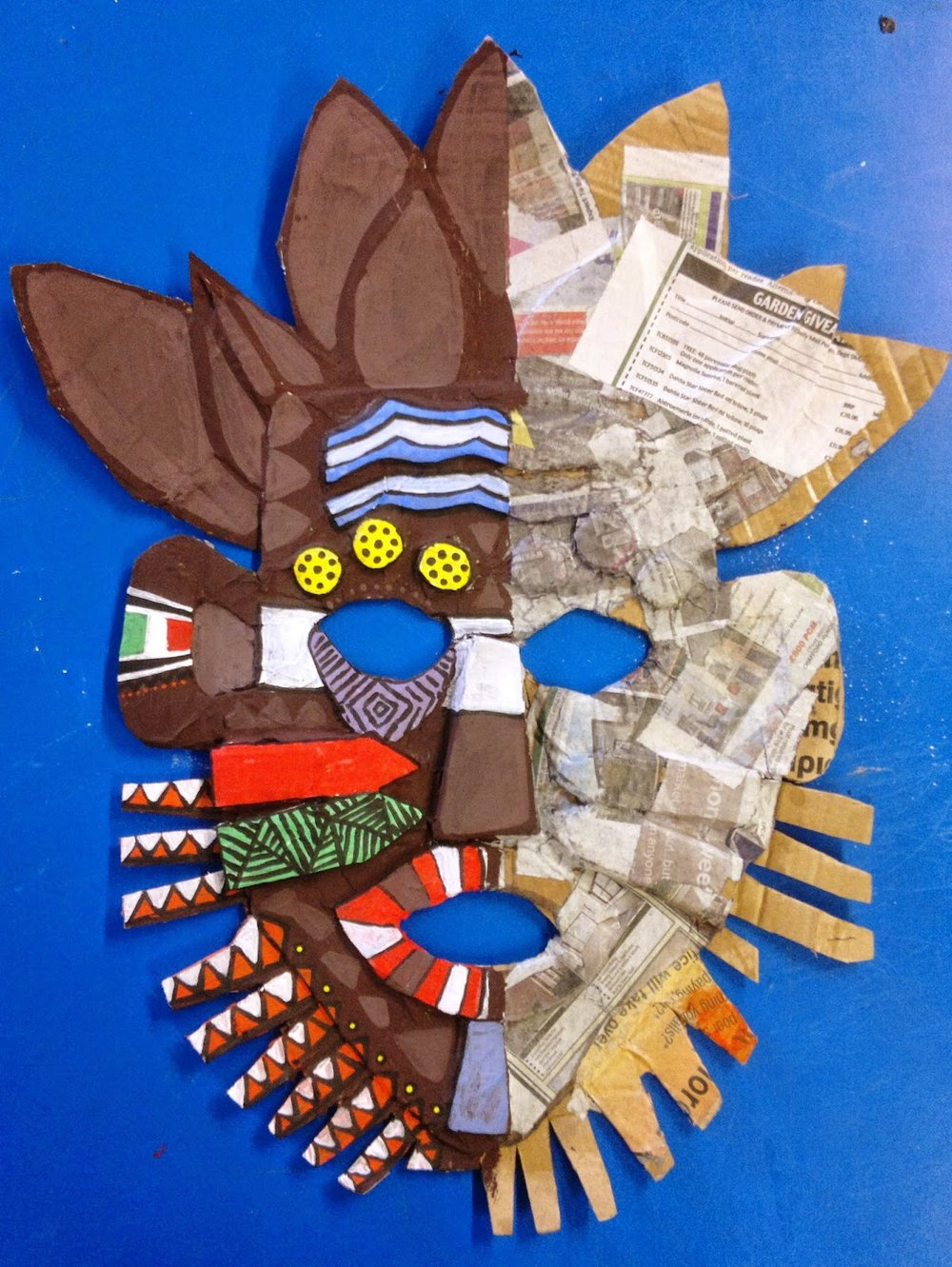 Almost done - This mask is also a relief sculpture.  It has been done with cardboard and paper mache.  The contrast between the earthy brown and the bright colors of the design give it a rich vibrant feel.