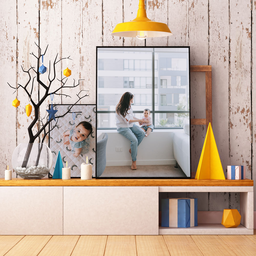 Large photo prints displayed in the home
