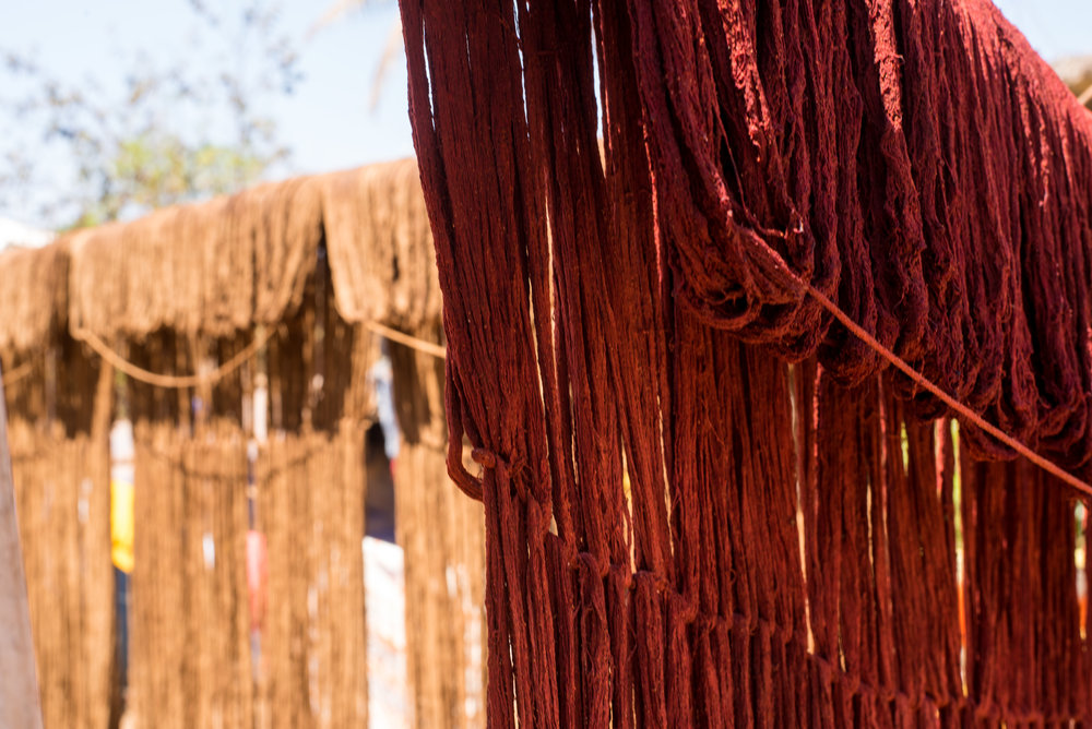 Dyed yarn drying on bamboo poles