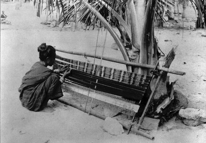 An ikat weaver with her loom, circa 1915