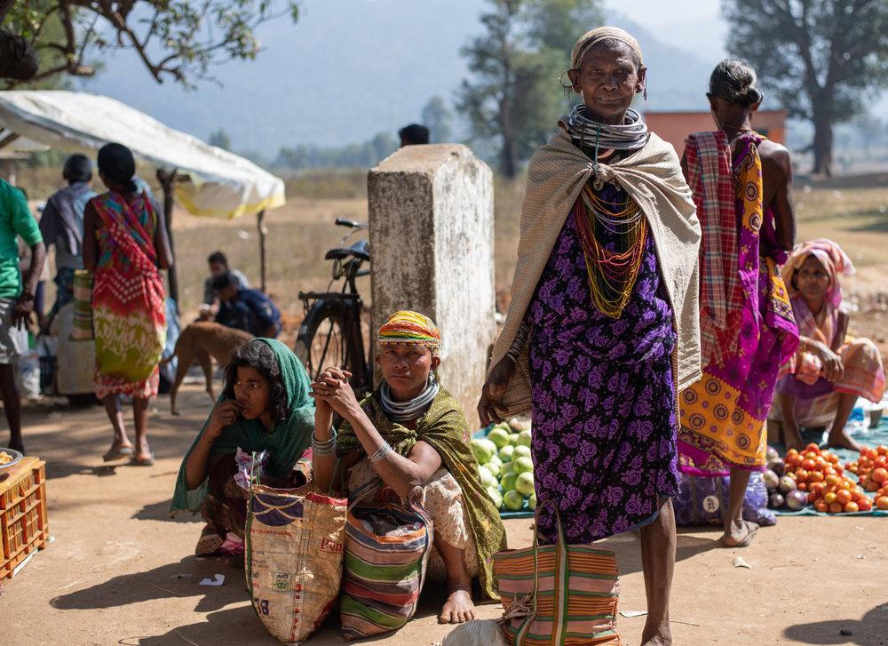 Bonda women exchanging goods at the local market.