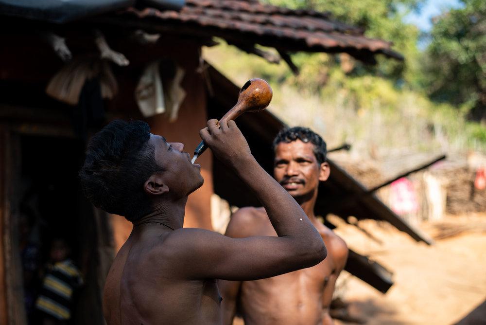 Bonda man enjoying a drink