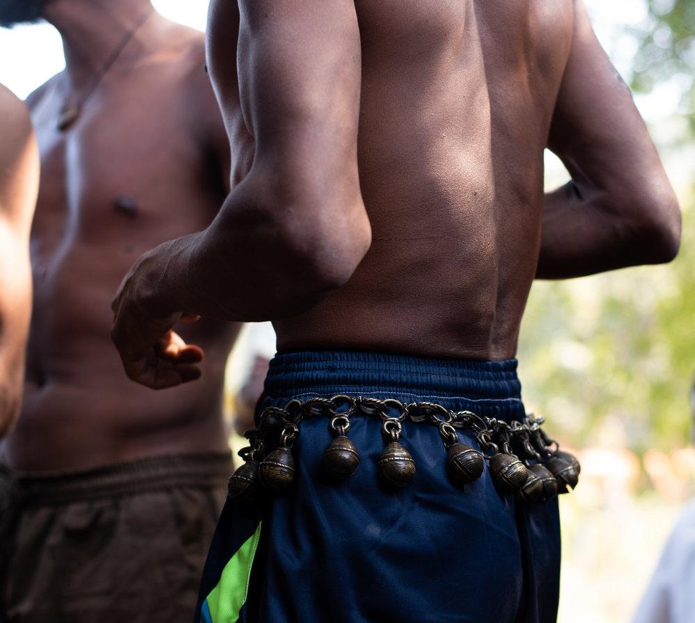 Men wear bells around their waist for the 'Jhati Parab'