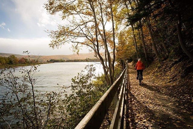 Taking in the fall colours on our bikes was so refreshing. This is Freshwater Lake trail in Ingonish, Cape Breton. Just can't get enough of nature! . . . . . #explorecb  #visitnovascotia  #capebreton @visitcapebretonisland  @visitnovascotia