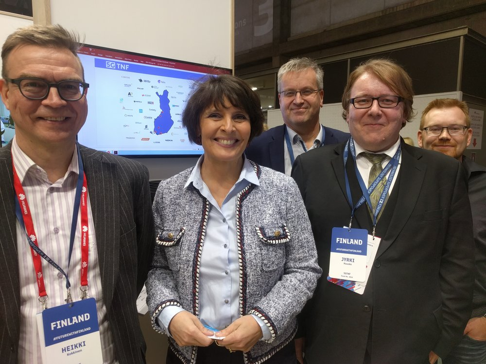 Anne Berner, Minister of Transport and Communications of Finland visiting the 5GTNF booth and LuxTurrim5G hosted by Sami Ruponen, VTT.