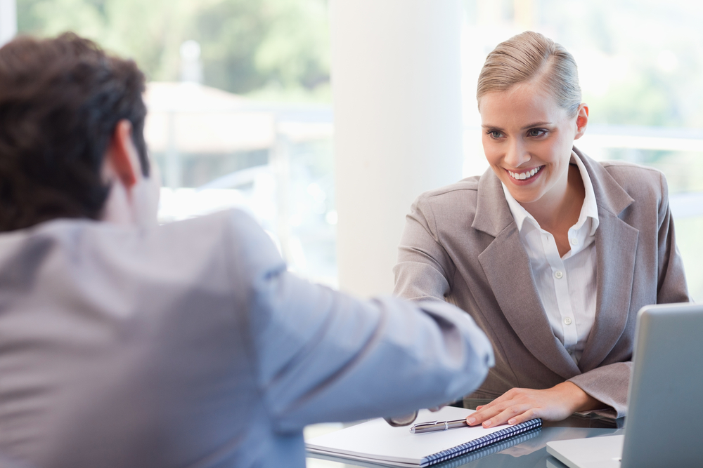 Manager interviewing a male applicant in her office.jpeg