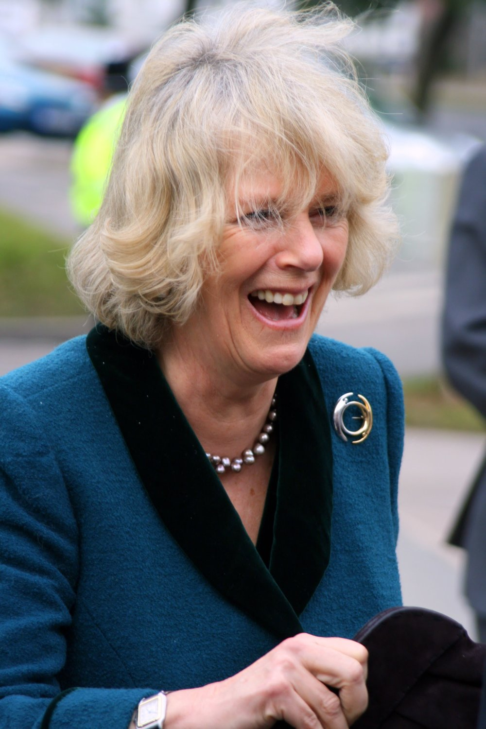 HRH The Duchess of Cornwall visits Rotherham General Hospital. The Duchess had entrusted an Aide with her handbag, was getting in her car and remembered she had forgot it, and burst out laughing when the Lord Lieutenant joked there'd been a theft! - Date: February 2009. Photographer: Paul Ratcliffe