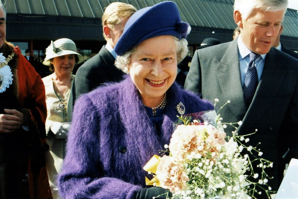 HM The Queen on a walkabout outside Crewe Railway Station. I just pressed the camera shutter button at the right moment and got what looks like a posed photo!!! - Date: June 1995. Photographer: Paul Ratcliffe
