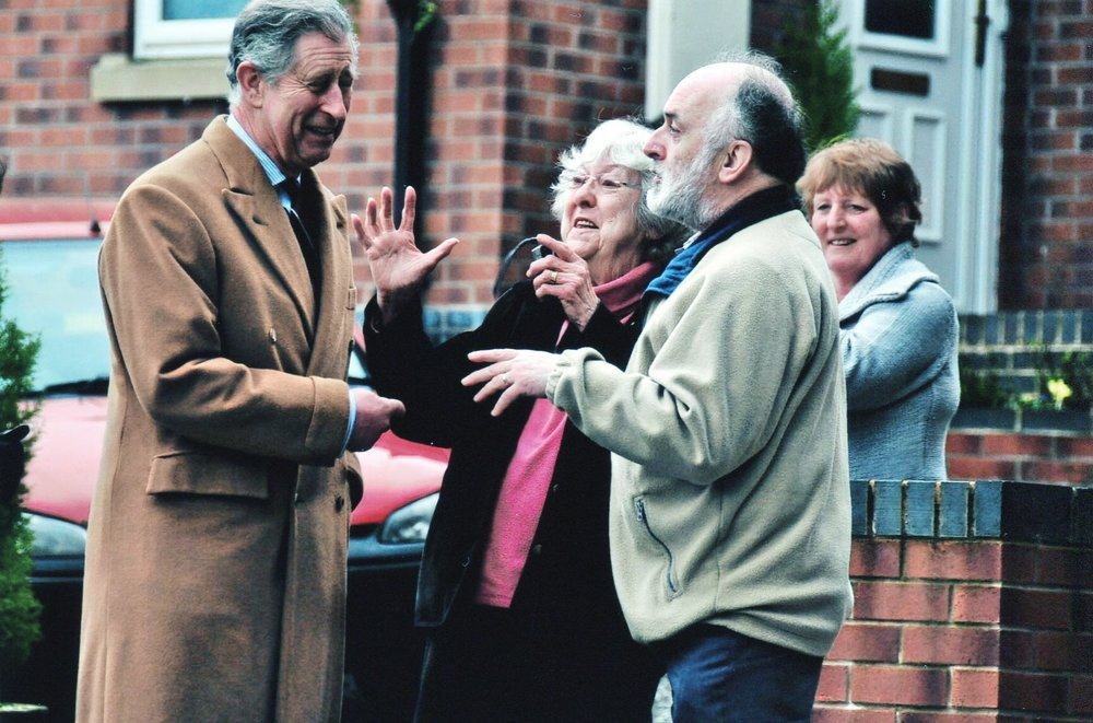 This picture is of my mother and stepfather, Pauline and David Roberts, explaining to the Prince of Wales why their village of Froncysyllte is a great place to live. My mother's excitement and Prince Charles amusement is written all over their faces and demonstrated by their frenetic gesturing. Sadly they have both since died but this picture always makes me smile and reminds me of the endless tales of the day they met Prince Charles! It also sums up how our Royal Family spreads so much happiness across the land. Photographer: Sarah Brown
