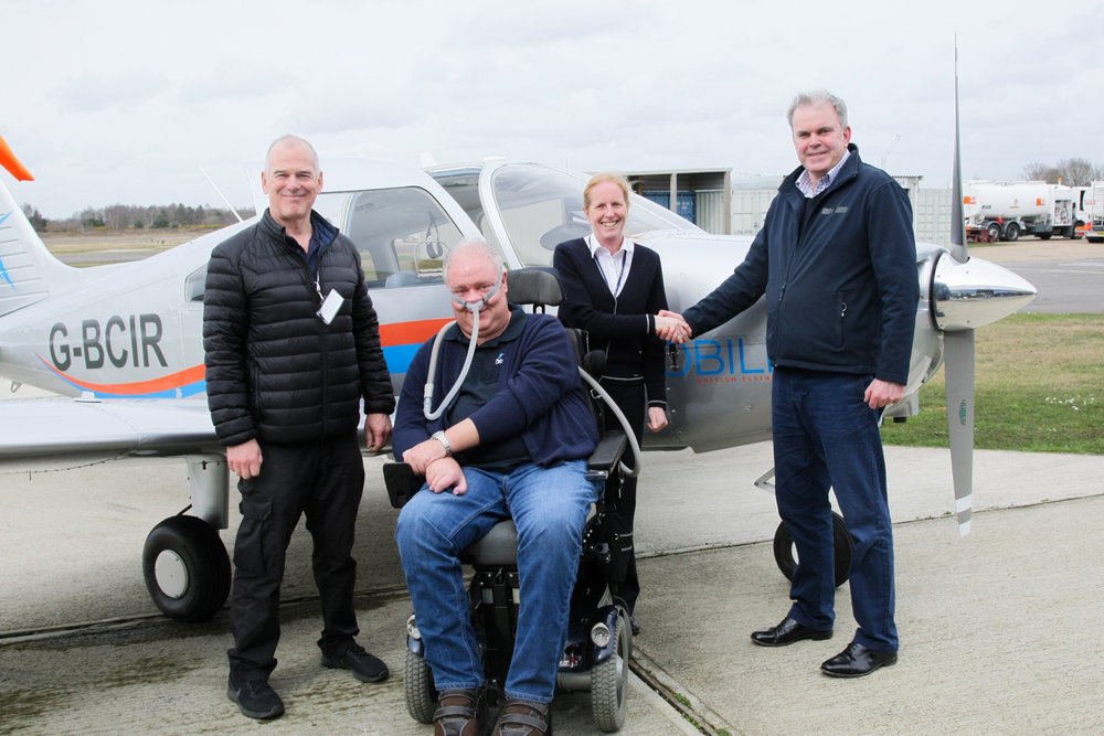 Reborn Aviation Founder Edmund Hewertson handing over the aircraft to Aerobility CEO Mike Miller-Smith,  Chairman Shona Bowman and CFI Mike Owen