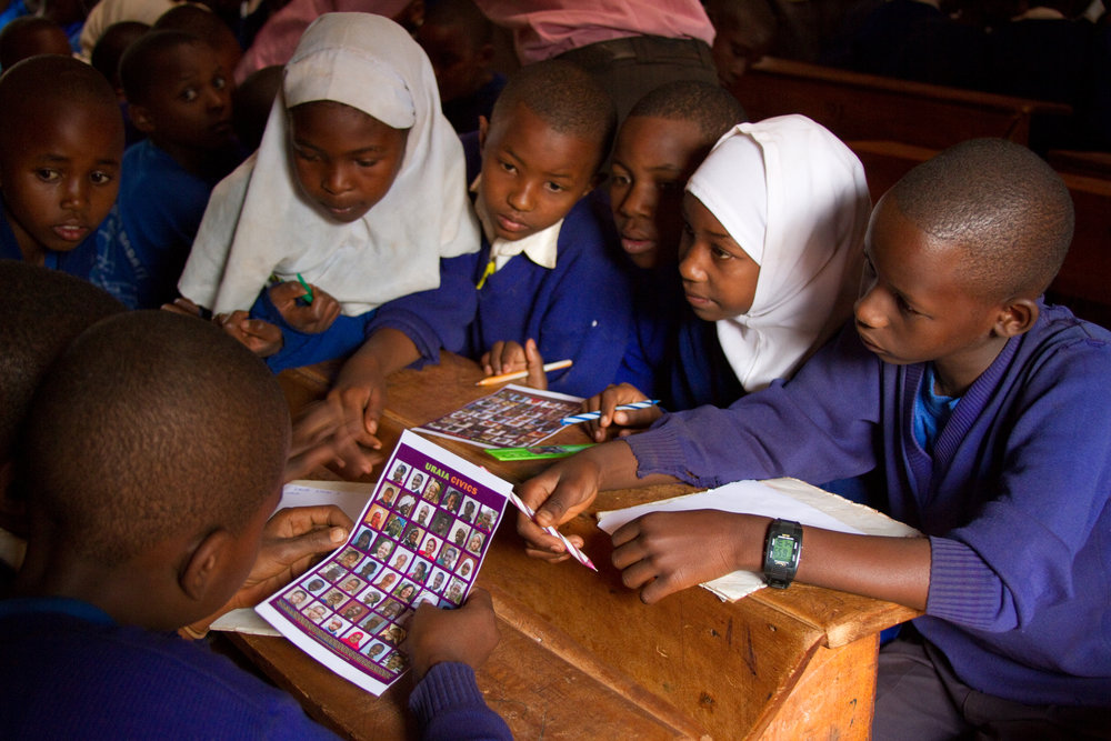 Tanzanian primary school students using a Civics poster in the classroom