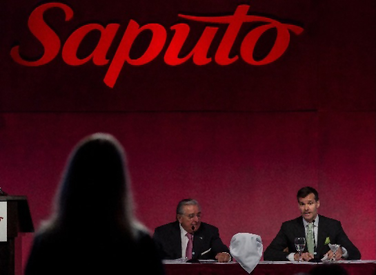 Krista confronting Saputo board regarding their animal welfare policies.