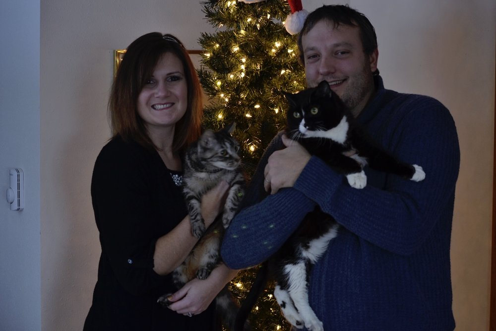 Our little family. Miss the kitties so much.