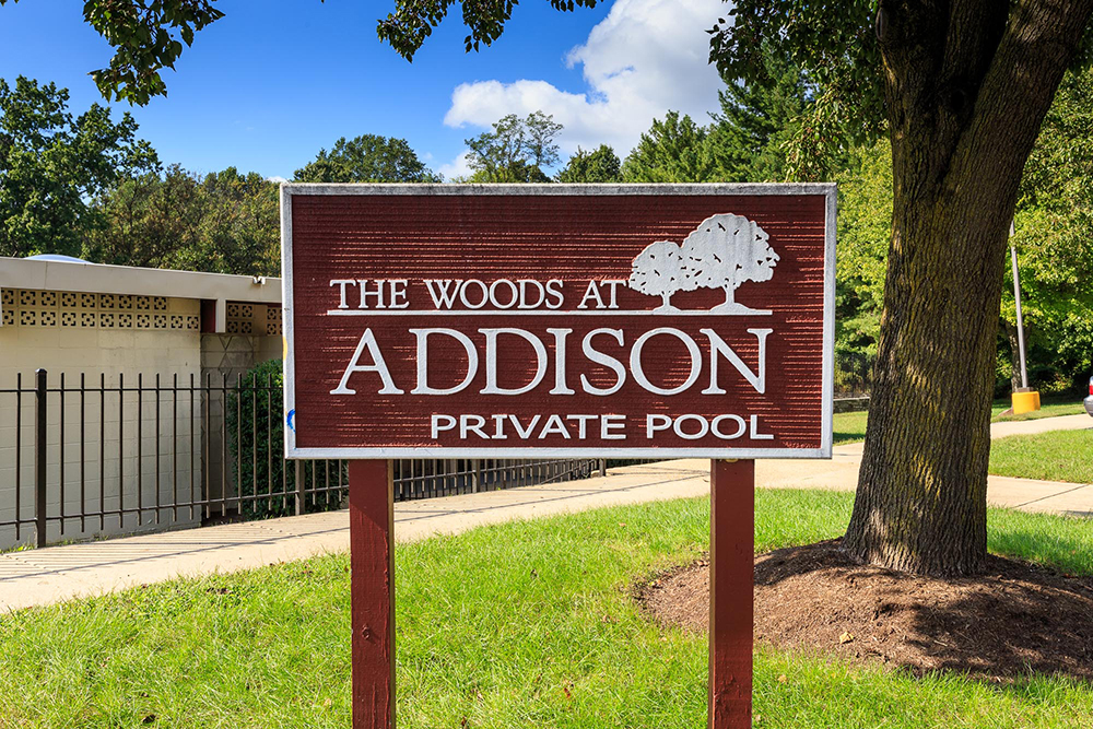 1000px_Woods_at_Addison_OCT_2013_pool sign.jpg