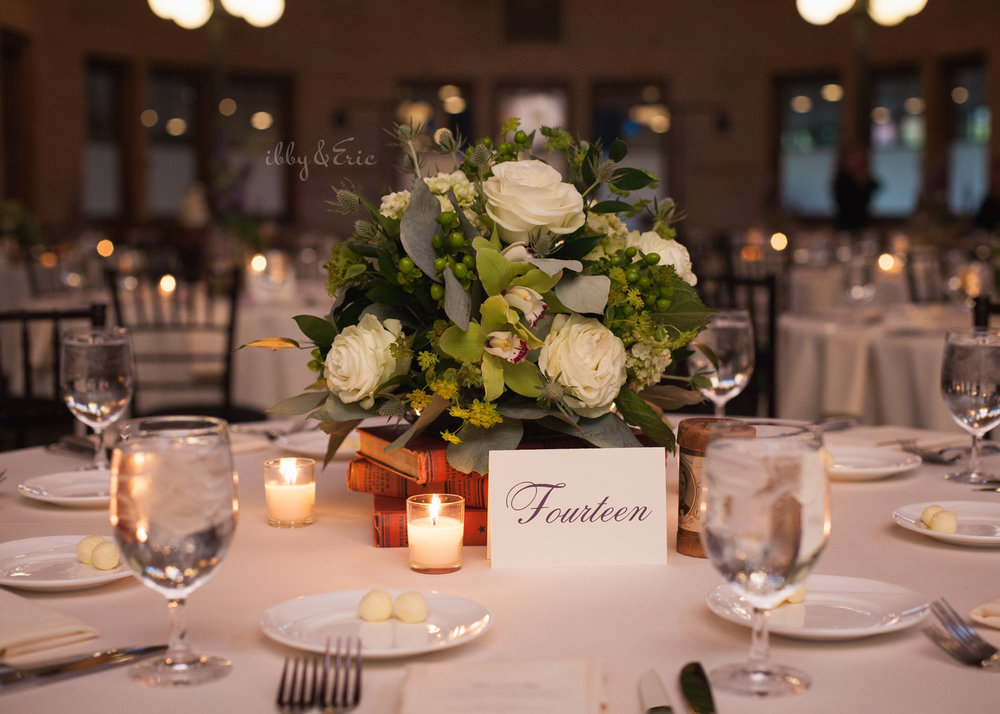Wedding centerpiece with white roses and flowers with candles