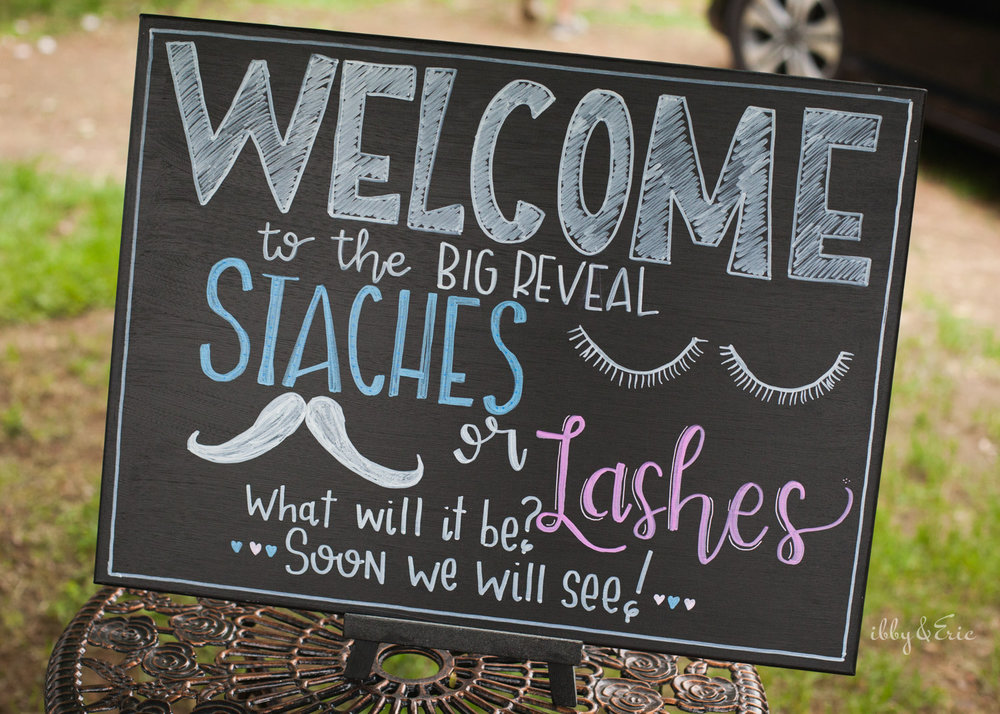 Staches or lashes chalkboard sign design for gender reveal party in western Massachusetts.