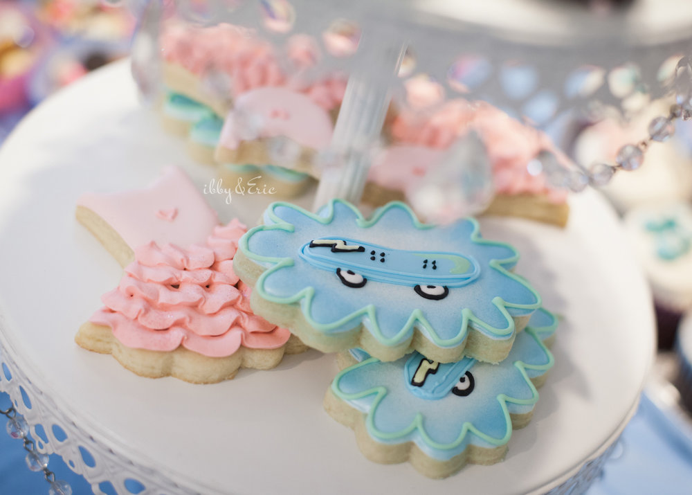 Pink dress and blue skateboard gender reveal cookies by the Ginger Baker in Springfield, MA.