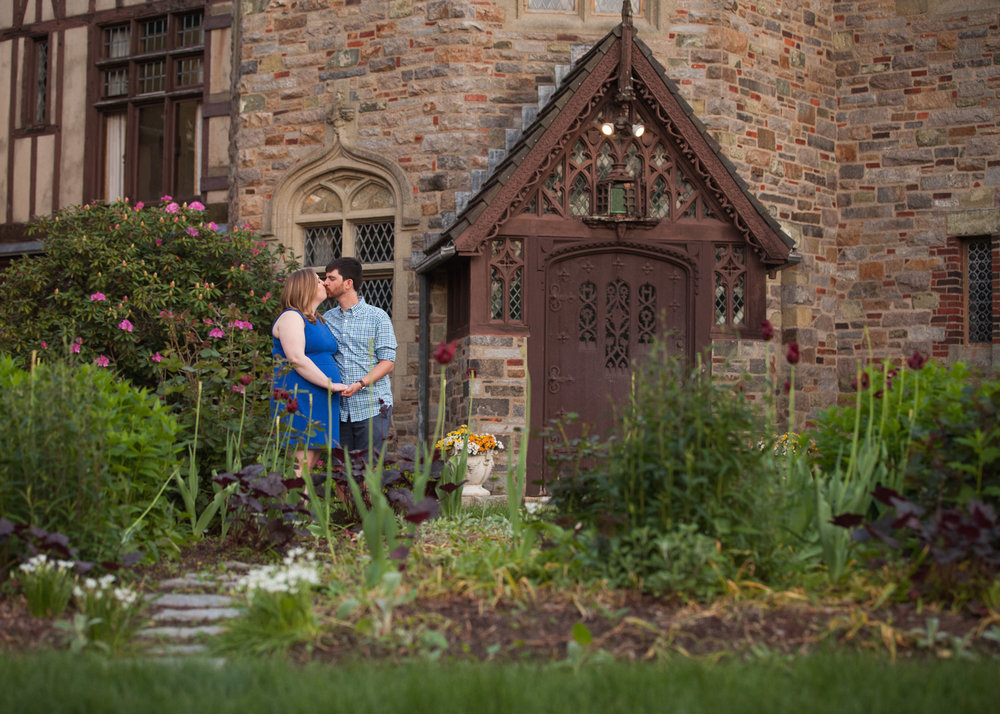 Man and woman kiss in the garden front of WPI's Higgins House.