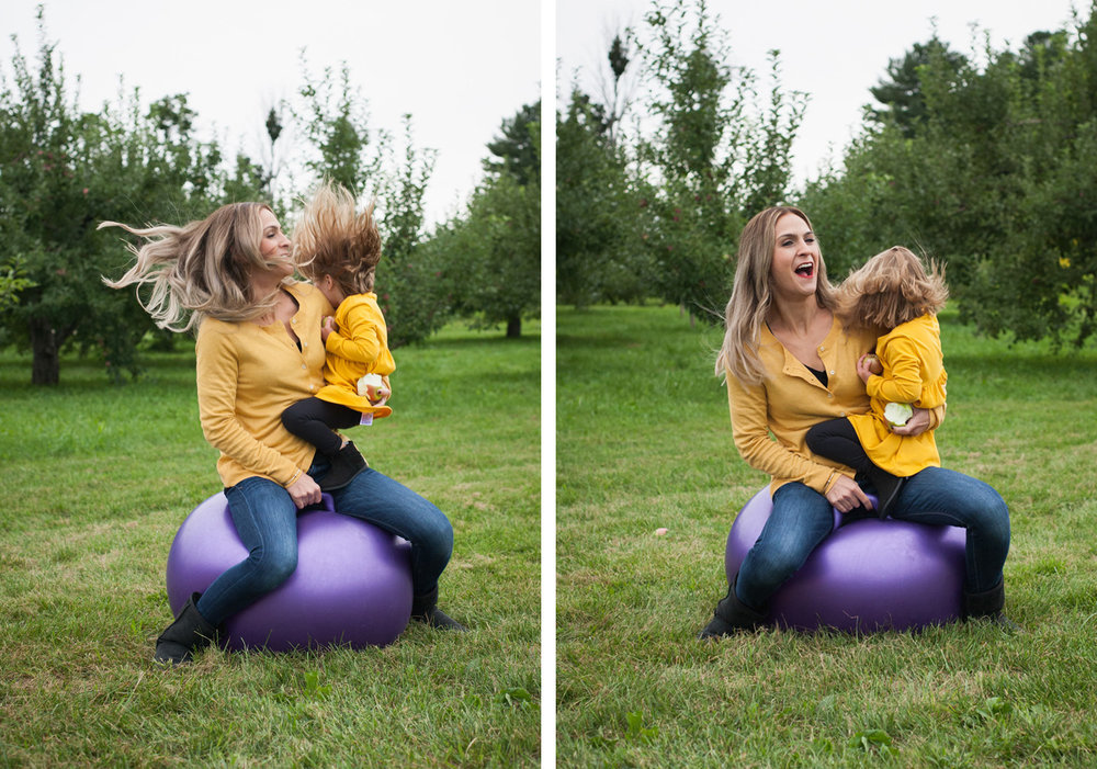 Mom & toddler daughter wearing yellow bounce on a big purple ball.