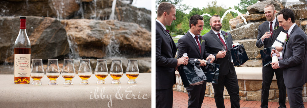 A groom gifts whiskey decanters to his happy groomsmen while they stand in front of a rock fountain.