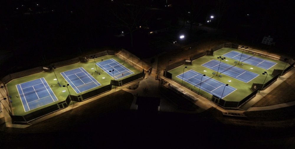 Distinguished Outdoor Tennis Facility Award in 2017 from the ASBA for the Southern Wesleyan Tennis Facility in Central, SC. New construction of 6 courts with sidewalks, lights and fencing. -