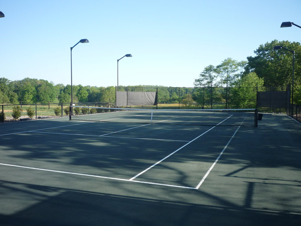 Distinguished Residential Tennis Facility in 2014. New construction of a private residence in Tennessee using a sub-irrigated clay court system with fencing, curbing, court lighting and playing lines.  -