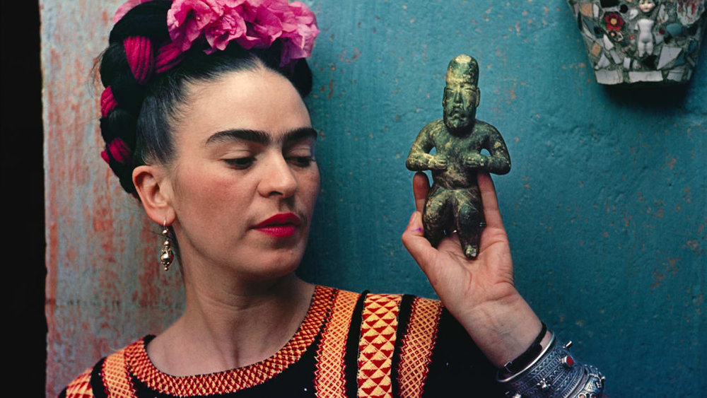 How Frida Kahlo's Fashion Influenced Mexican Politics   - Frida Kahlo's heavy unibrow and technicolor clothes are as recognizable as her art. But, like her surreal portraits, Kahlo's fashion was also layered, heavy with meaning and political intention. Through her dress, she constructed an ethnic and political identity that spoke of the same duality found in her paintings, and sent a highly political statement of cultural identity, nationalism, and feminism.