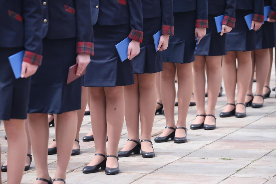 "Girls' Uniform Skirts Replaced by Trousers   - A recent analysis of uniform policies in England show that at least 40 secondary schools have shifted from skirts to trousers as a way to cater for transgender pupils. Some schools say that skirts are ""undignified and embarrassing"" if girls sat on the floor for assembly, and others respond that a ban on skirts is ""sexualizing"" students' bodies. Other critics argue that true freedom means students can either wear trousers or skirts. In Japan, more schools are implementing unisex uniforms or flexible codes to support transgender students as well."
