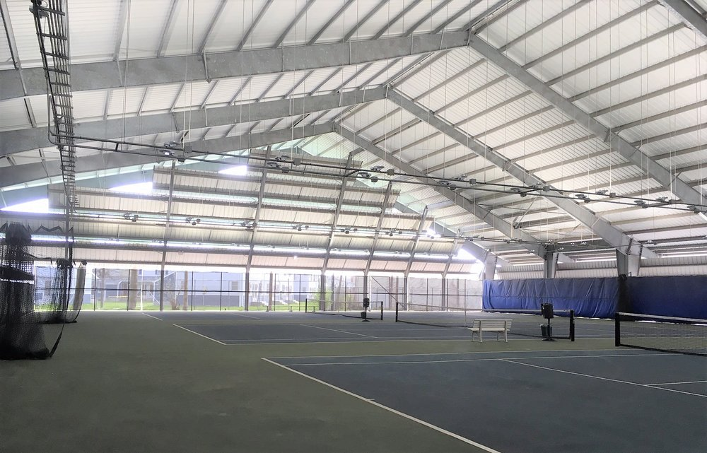 Last week our crew finished installing our LED lighting on the 3 covered courts at the H.E.B. Tennis Center, in Corpus Christi, Texas. Check out the dramatic difference in lighting levels in the before and after photos taken by our team. H.E.B. Tennis Center is part of the Corpus Christi Parks and Recreation Department and is one of two full-service tennis centers offering quality courts for play, private and semi-private lessons, leagues and tournaments. H.E.B. features 25 lighted Laykold courts (including the 3 covered ones), a large pro shop, lounge and locker room. We love our Texas customers!. Click  here  to check out their website.
