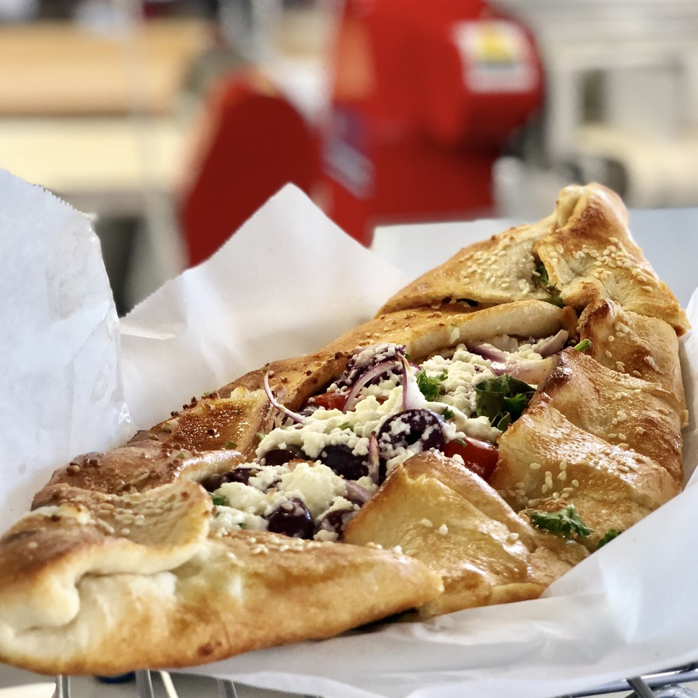 Our Greek Fatayer - fresh spinach, chopped tomatoe, red onions, calamata olives, Greek feta cheese, and fresh garlic