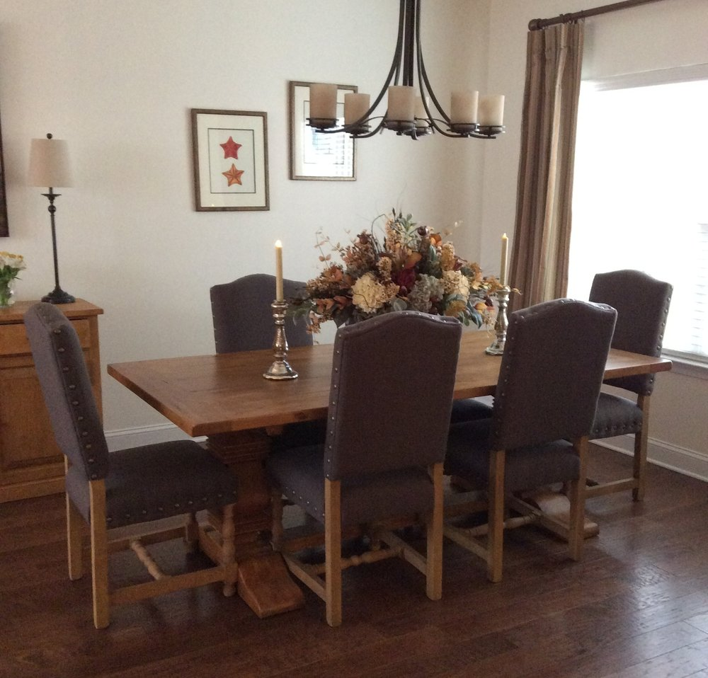 A warm and inviting dining room - A custom floral arrangement from Creative Displays of Tinton Falls adds interest and height to the Dining Table. The result is a warm, inviting, timeless room which truly reflects my clients and their new lifestyle.