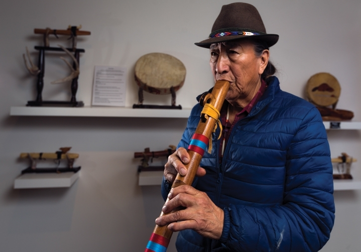 Helmer Twoyoungman plays his hand carved love flute. Photo by Aryn Toombs/Rocky Mountain Outlook