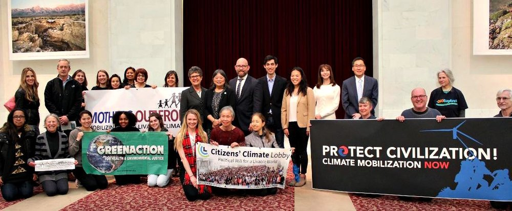 San Francisco Supervisor Rafael Mandelman and supporters announce the declaration of Climate Emergency resolution in February. (Image: Mothers Out Front)