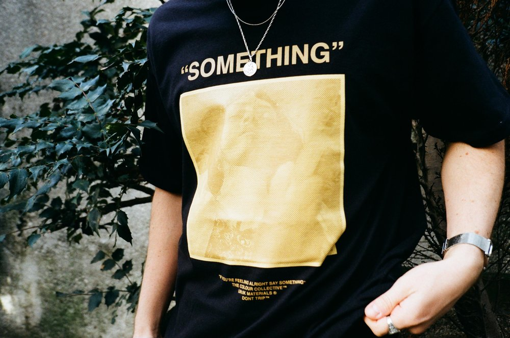 COLOUR COLLECTIVE 'SOMETHING' TEE -  first introduced in mustard, the best seller for CC - period. The 'Pulp Fiction' concept that fitted the originality of the brand so well. Flipped in this special black colourway for the 5 year special.