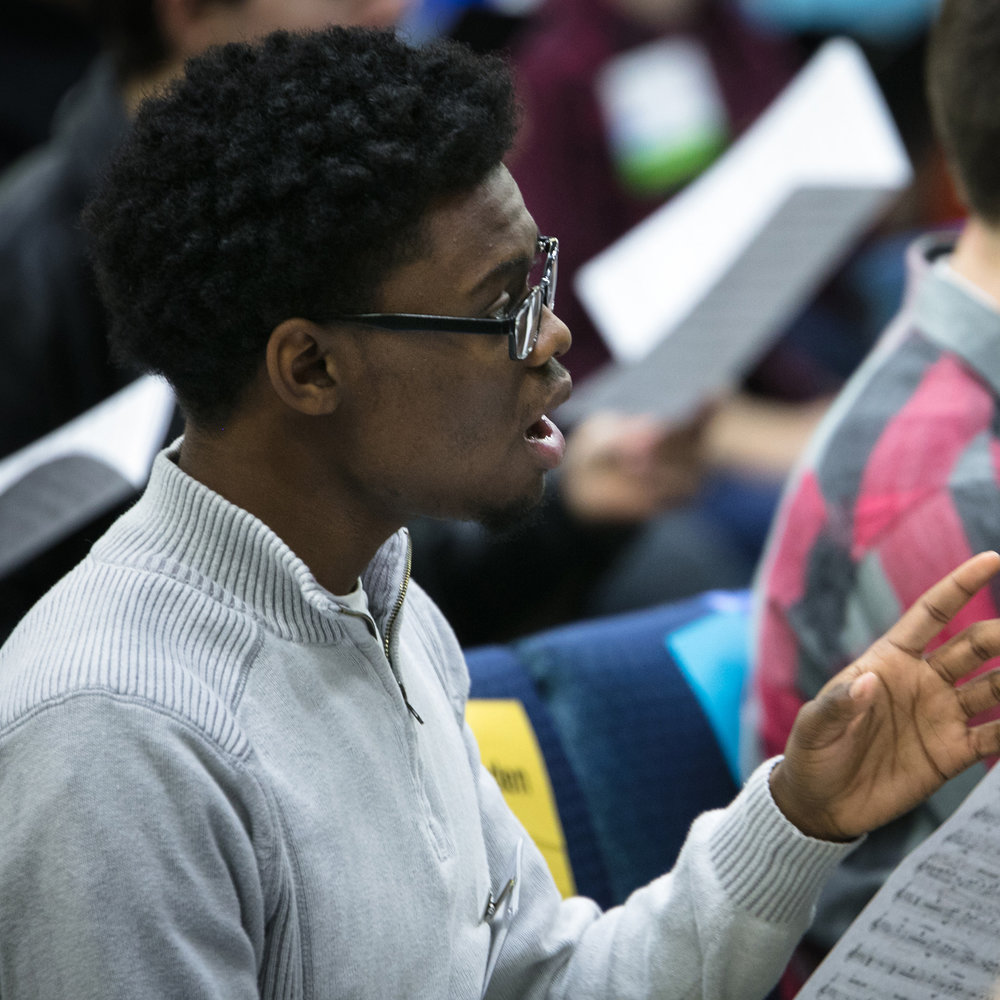 Male vocalist in in All-State Chorus rehearsal; click through to Chorus Division Page