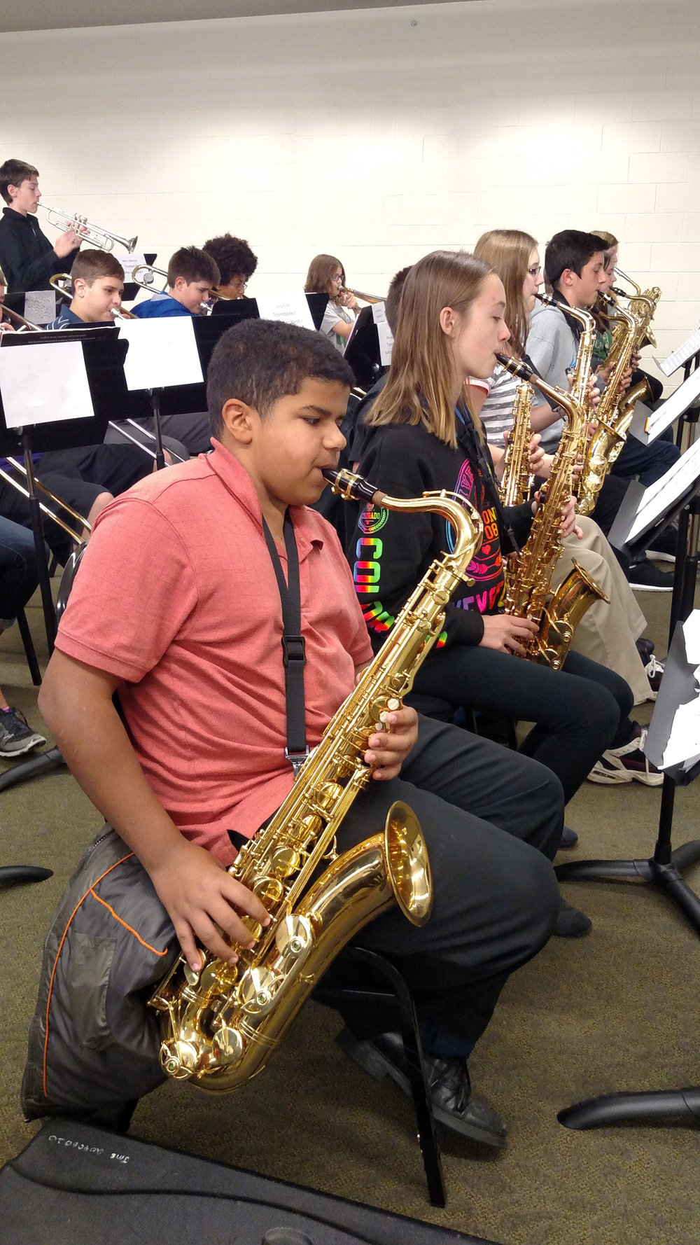 Student saxophone player in rehearsal at a district festival